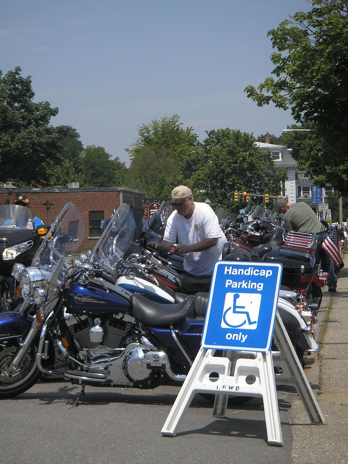 Motorcycles parked along Beacon Street while visiting the Harley Davidson set up, 2010